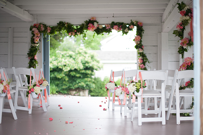 an intimate ceremony inside a barn
