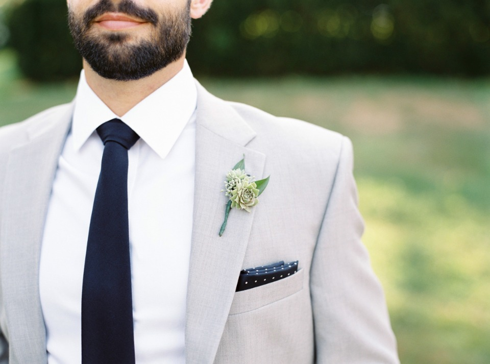 Light grey suit with a dark tie