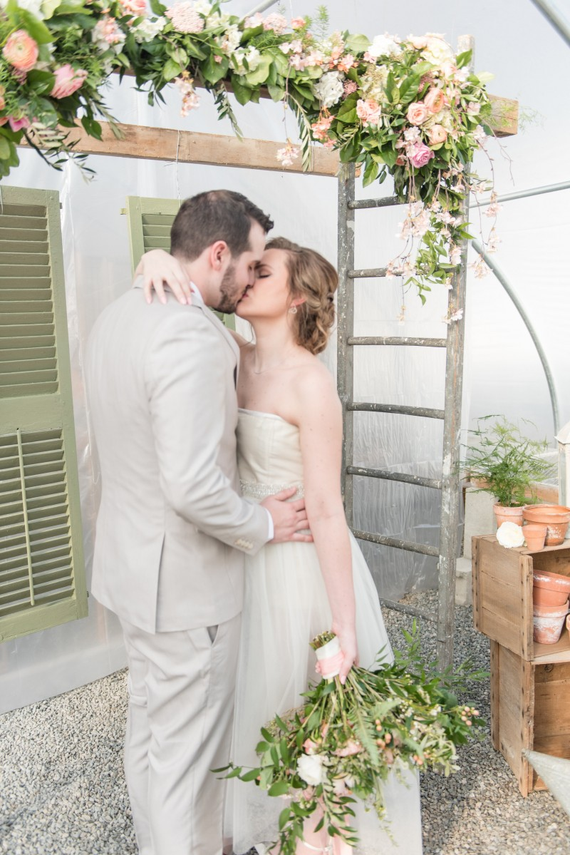 Bride and Groom under trellis